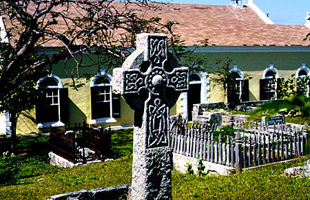 Wesley Church (1843) with Celtic cross in graveyard in Harbour Island. The Bahamas.