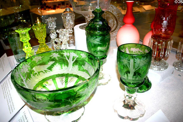 Green engraved Console set of bowl & covered glasses (1918-38) made in Czechoslovakia copying antique Bohemian design in Maine State Museum. Augusta, ME.