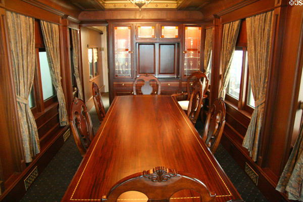 Antique dining table in Union Pacific private passenger car at Durham Western Heritage Museum. Omaha, NE.