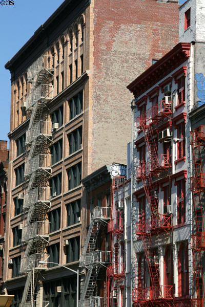 Streetscape of fire escapes along White Street. New York, NY.