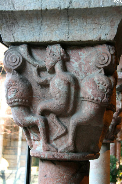 Man blowing horn between beasts carved on capital of Cuxa Cloisters at The Cloisters. New York, NY.