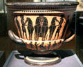 Greek ceramic black figure on red krater painted with warriors & horses at Kunsthistorisches Museum. Vienna, Austria.