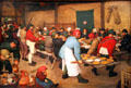 Peasant Wedding painting by Pieter Brueghel the Elder at Kunsthistorisches Museum. Vienna, Austria.