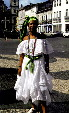 Woman in regional dress of Salvador in town square. Brazil.