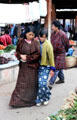 A family looks at the vegetables for sale at the Saturday market in Thimpu. Bhutan.