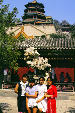 Family posing in front of a building at the Summer Palace park, Beijing. China.