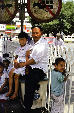 Father sits with his children in Urumqi. China.