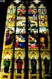 Stained glass windows of Cologne Cathedral showing descent from Cross over row of four Apostles. Köln, Germany.