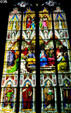 Stained glass windows showing the Cathedral's name saints Peter & Mary over row of four Doctors of the church. Köln, Germany.