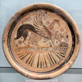 Greek terracotta plate with winged Sphinx from Eastern Greece at Antikensammlungen. Munich, Germany.