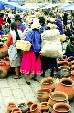 Women in native dress in the market of Cuenca. Ecuador.
