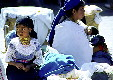 People of all ages attend the Otavalo market which is also a weekly social event. Ecuador.
