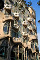 Balconies & window bays project from facade of Gaudi's Casa Batlló. Barcelona, Spain.