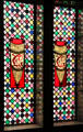 Stained glass window with EG initials over stairs on main floor at Palau Güell. Barcelona, Spain.