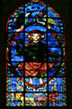 Stained glass window of Christ with four Apostles in Cathedral St. Étienne. Auxerre, France.
