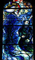 Detail of kneeling man from stained-glass by Marc Chagall in Cathedral. Metz, France.