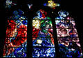 Red, blue, purple series of three stained-glass windows by Marc Chagall in Cathedral. Metz, France.