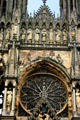 Facade side of rose window on Cathedral which has been rebuilt since total destruction in World War I. Reims, France.