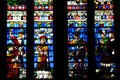 South transept stained glass windows of St. Stephen's Cathedral with figures in Medieval dress. Sens, France.