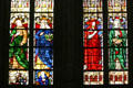 Stained glass window of St. Stephen's Cathedral with robed people. Sens, France.