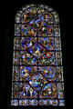 Stained glass window of St. Stephen's Cathedral with Biblical stories. Sens, France.