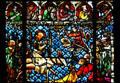 Stained glass entry of Christ into Jerusalem in Cathedral. Strasbourg, France.
