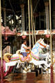 Horse & young rider on carousel in Place Guttenberg. Strasbourg, France.