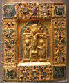 Bejeweled binding box for manuscript with crucifixion & symbols of evangelists from Germany at Louvre Museum. Paris, France.