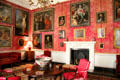 Red Drawing Room with collection of old masters oil paintings at Castletown House. Ireland.