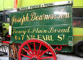 Horse-drawn two-wheeled door-to-door bread delivery van for Joseph Downes & Son Ltd. at National Transport Museum. Howth, Ireland.