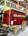 Horse-drawn four-wheeled door-to-door bread delivery van for John Boland at National Transport Museum. Howth, Ireland.