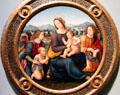 Madonna & Child with four angels & St. John the Baptist painting by Lorenzo di Credi & workshop at Uffizi Gallery. Florence, Italy.