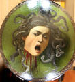 Head of Medusa parade shield by Caravaggio at Uffizi Gallery. Florence, Italy.