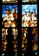 Devils in stained-glass of Duomo. Milan, Italy.