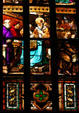 Holy clergy in stained-glass of Duomo. Milan, Italy.