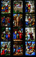 Scenes of stained-glass saints in Duomo. Milan, Italy.