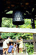 Children ringing a bronze bell in a Hida Folk Village, Takayama. Japan.