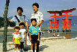 Japanese family posing near a Torii, Miya-jima. Japan.