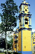 Yellow & blue stucco colors a church in Cholula. Mexico.