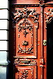Detail of a red carved door in Puebla. Mexico.