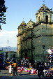 Visitors & merchants in front of Cathedral in Oaxaca. Mexico.