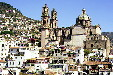 View of town of Taxco & its church from afar. Mexico.