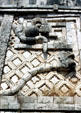 Rattlesnake sculpture in Uxmal winds its way around a building in Nunnery Quadrant & finds its tail again. Mexico.