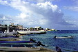 Buildings & boats docked on shore of Cozumel. Mexico.