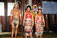 Group of dancers in native dress at Skrang longhouse in Sarawak. Malaysia.