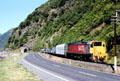 Tranzscenic passenger train on Coast south of Kaikoura on the South Island. New Zealand.