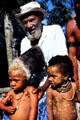 Chief of the Mudmen village with his two grandsons, one who is blond. Papua New Guinea.