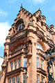 Red sandstone commercial building with sculptures. Glasgow, Scotland.