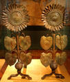 Sunflower brass andirons by Thomas Jeckyll of England at Hunterian Art Gallery. Glasgow, Scotland.
