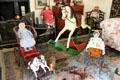 Rocking horse, riding toys & doll carriages in nursery at Kellie Castle. Pittenweem, Scotland.